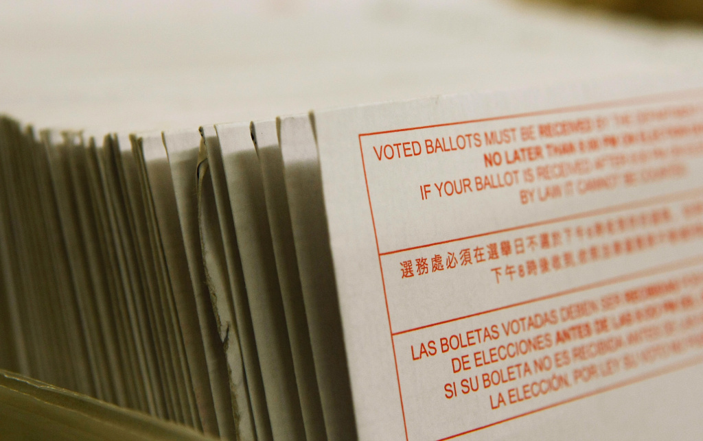File: A stack of vote-by-mail ballots sit in a box after being sorted at the San Francisco Department of Elections January 24, 2008 in San Francisco, California.