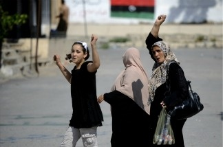 Libyan women cheer in Tripoli, on August 23, 2011.