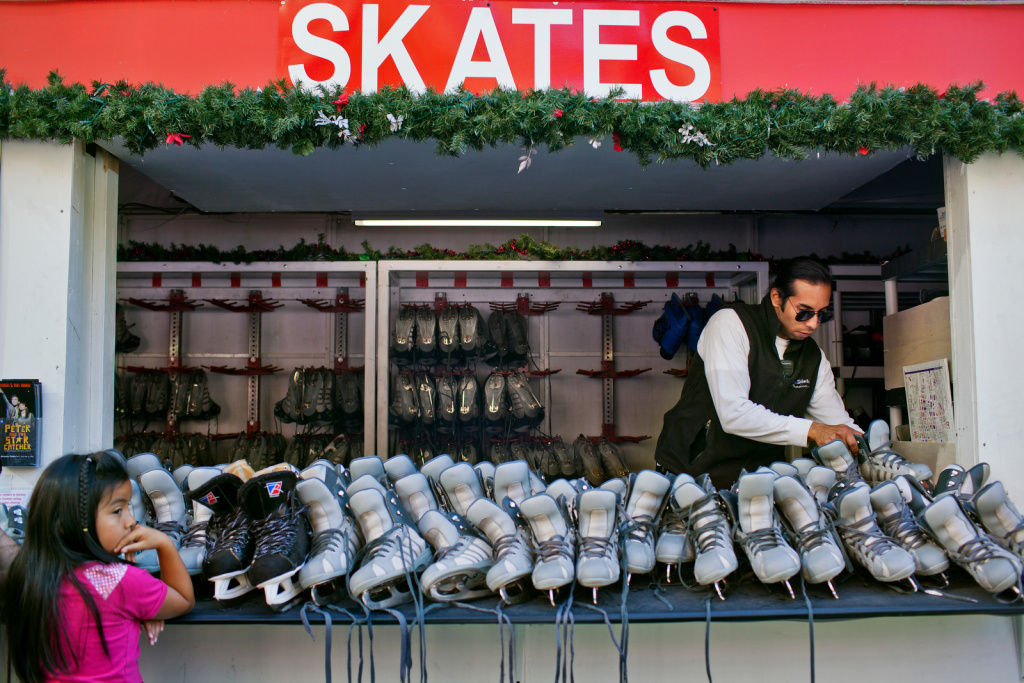 Workers disinfect skates during Downtown on Ice at Pershing Square on Christmas Eve.