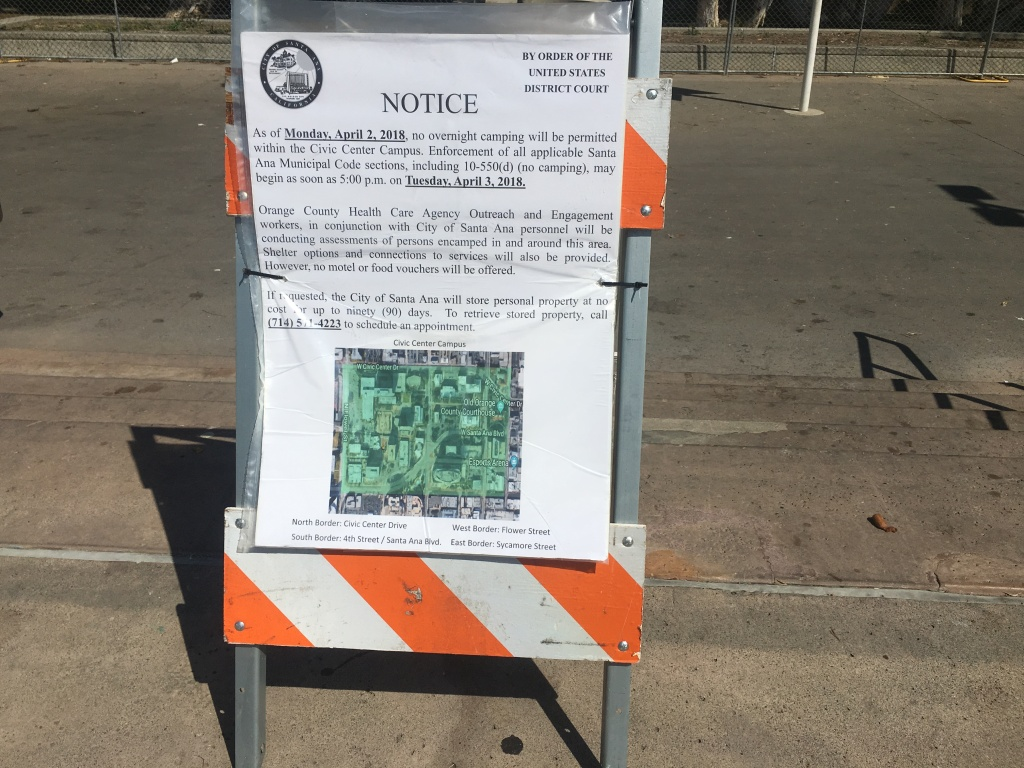 The notice telling residents of the Santa Ana Civic Center homeless encampment that overnight camping will no longer be permitted.