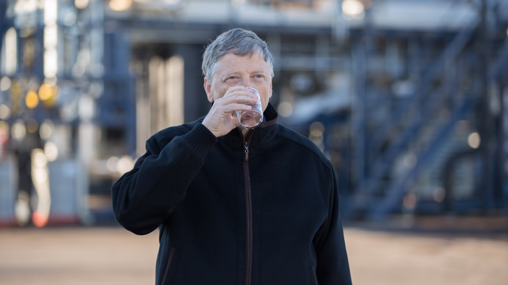 Bill Gates takes a sip of water that came out of the new Janicki Omniprocessor, which turns human waste into clean drinking water in minutes.