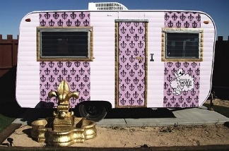 The Fifi trailer features lush purple interior. Hicksville, Joshua Tree, California.