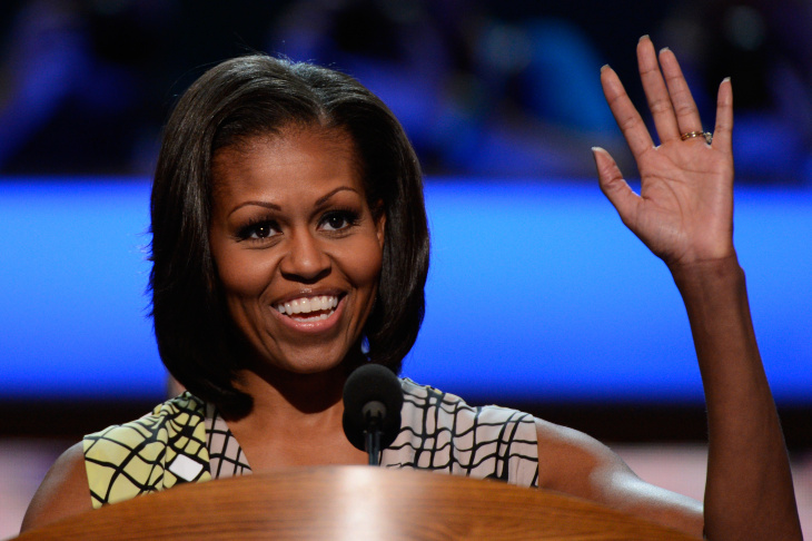 First lady Michelle Obama waves at the podium during a soundcheck during preparations for the Democratic National Convention at Time Warner Cable Arena on September 3, 2012 in Charlotte, North Carolina. The DNC that will start on September 4 and run through September 7, will nominate U.S. President Barack Obama as the Democratic presidential candidate.