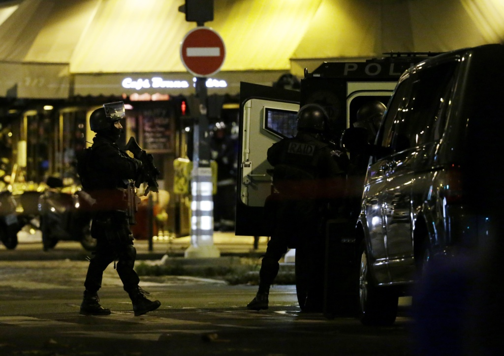 File: Police officers of the armed response unit man a position close to the Bataclan theatre on Nov. 13, 2015 after a series of gun attacks occurred across Paris as well as explosions outside the national stadium where France was hosting Germany.