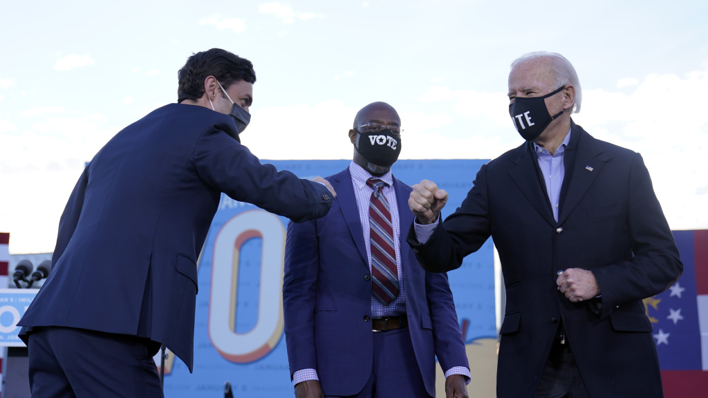 President-elect Joe Biden campaigned in Atlanta for Senate candidates Raphael Warnock (center) and Jon Ossoff (left). President Trump also traveled to Georgia to campaign for the Republican candidates.