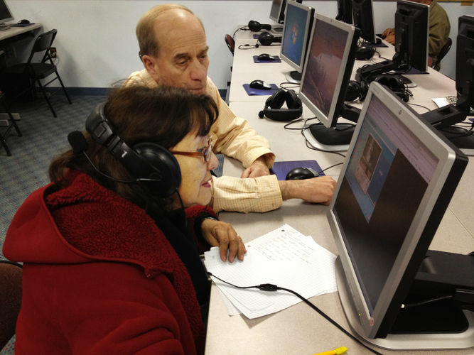 Donald Desmond teaches Abdesa Bustina to use a computer at the New Haven Adult and Continuing Education Center. The new GED will be offered only on computer, but many students here don't know how to use one.