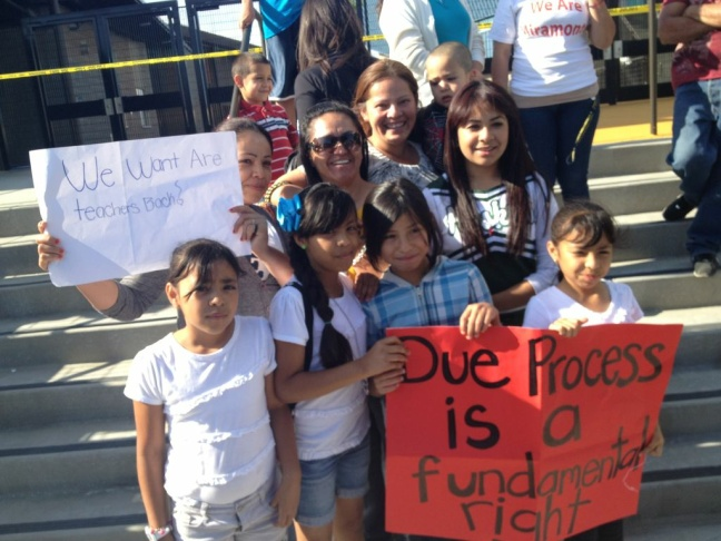 Miramonte Elementary School teacher (center with sunglasses) is surrounded by parents and students who came out to show support for the kindergarten teacher. (May 2, 2012)