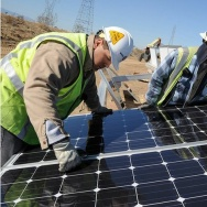 Electrical Construction Crew completes installation of one of 4,322 ground-mounted solar panels.