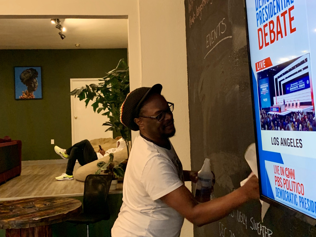 Lawrence Ross draws up a scoreboard for the Dec. 19, 2019 Democratic Presidential Debate watch party at co-working space The Metaphor Club.