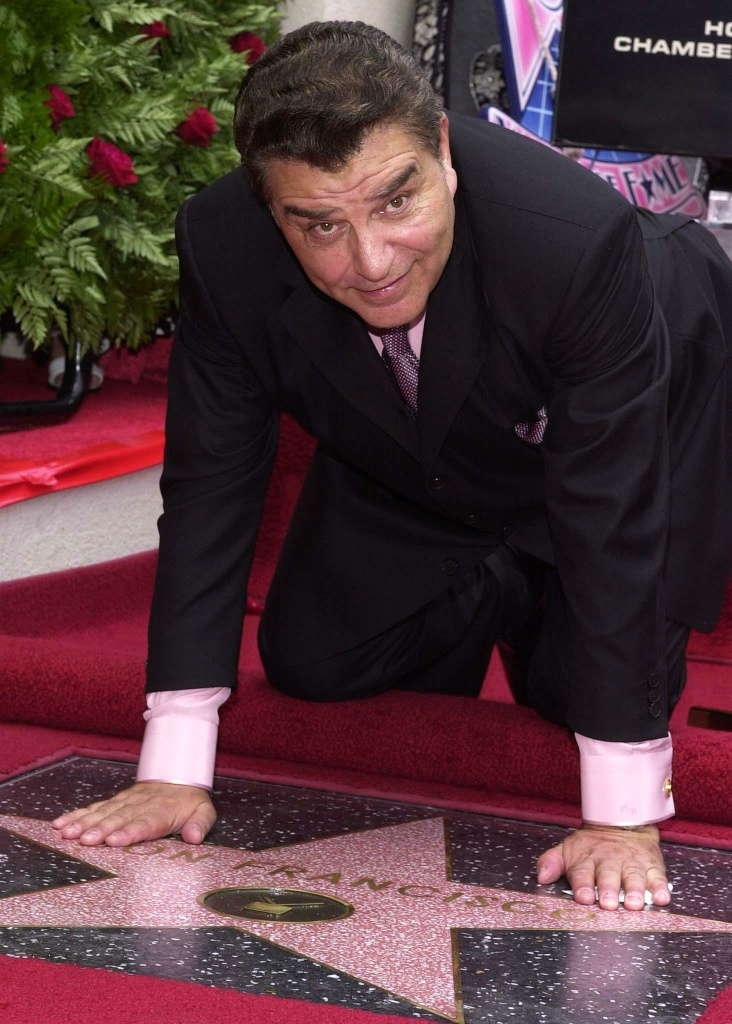 Chilean television host Don Francisco (Mario Kreutzberger) poses after a star was unveiled for him on the Hollywood Walk of Fame in Los Angeles, 08 June 2001. Don Francisco hosts Spanish television's 'Sabado Gigante.'