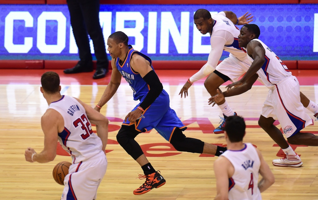 Russell Westbrook of the Oklahoma City Thunder heads for the basket being chased by Blake Griffin, Chris Paul (top), Darren Collison (R) and J.J. Redick (#4) of the Los Angeles Clippers in the fourth quarter on May 15, 2014 at Staples Center in Los Angeles, California, during game 6 of their NBA playoffs round two series in which the Thunder defeated the Clippers 104-98 to win the series by four games to two.