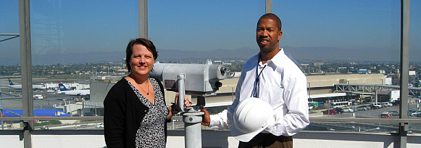 The view from atop the LAX Theme Building, with Trudi Sandmeier of the LA Conservancy and David McCombs of LAWA.  On Sunday, you can use the free telescopes to scan the horizon for planes...or the departures area for crazy drivers.