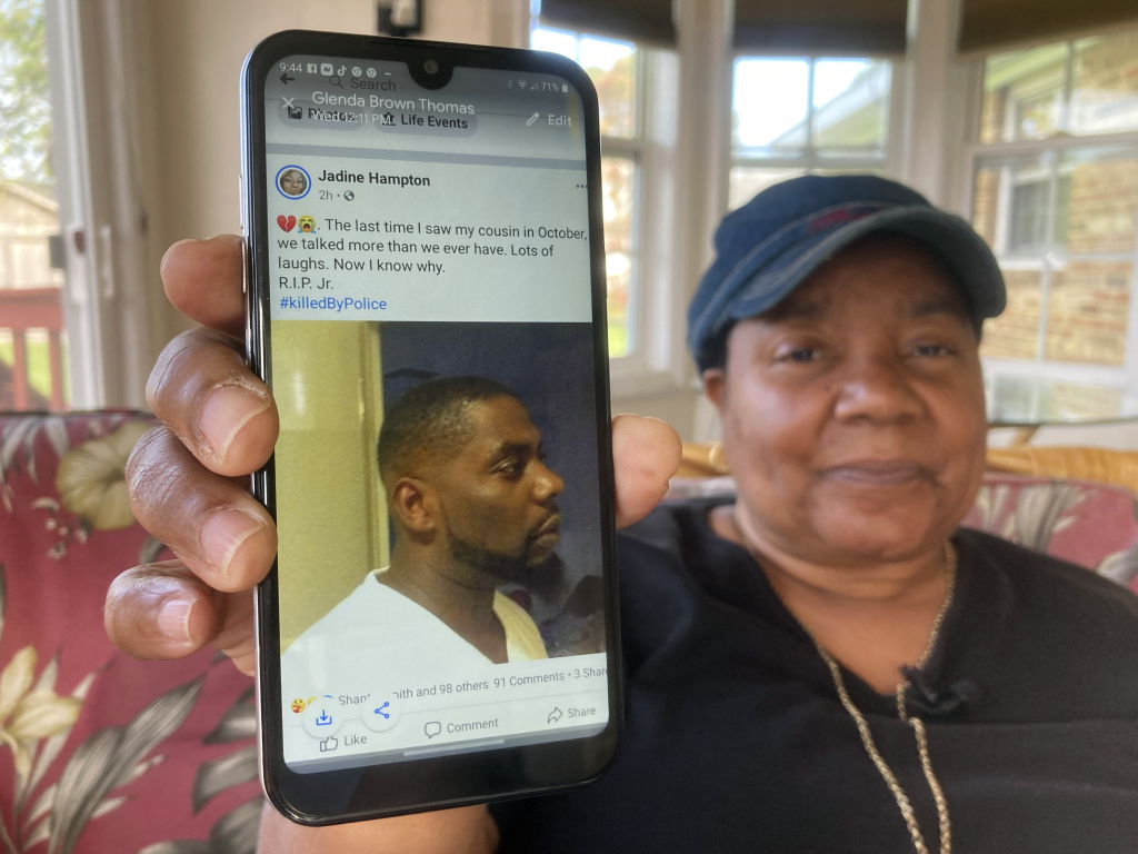 Glenda Brown Thomas displays a photo of her nephew, Andrew Brown Jr. on Thursday. He was shot and killed Wednesday by a sheriff's deputy who was attempting to execute a warrant.