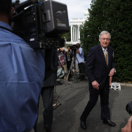 U.S. Senate Majority Leader Sen. Mitch McConnell (R-KY) leaves after he spoke to members of the media outside the West Wing of the White House.
