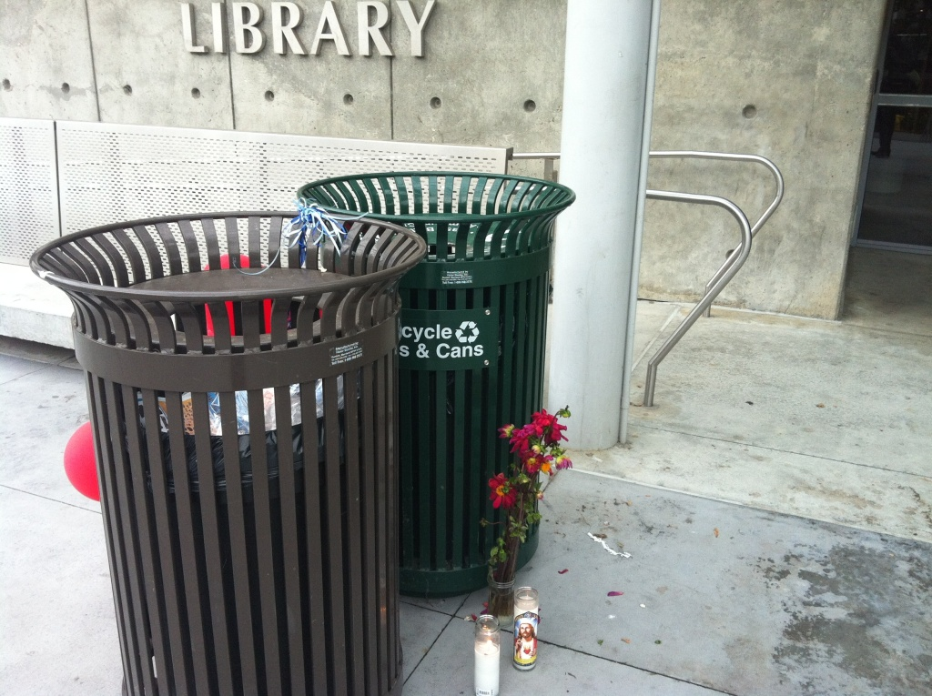 A makeshift memorial in front of the library at Santa Monica College. The college reopened Monday following a shooting Friday near and on the campus that left five people dead. The alleged shooter was shot and killed by police in the campus library, which remained closed Monday.