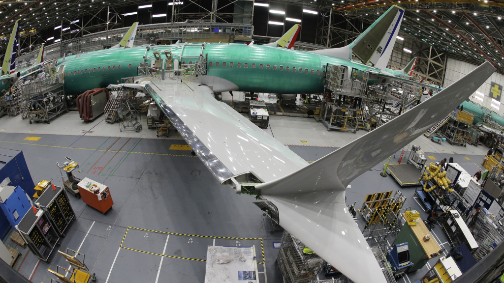 A Boeing 737 MAX 8 airplane sits on the assembly line on March 27, in Renton, Wash. Boeing is slowing production of its grounded Max airliner while it works on fixing flight-control software in the wake of fatal crashes.