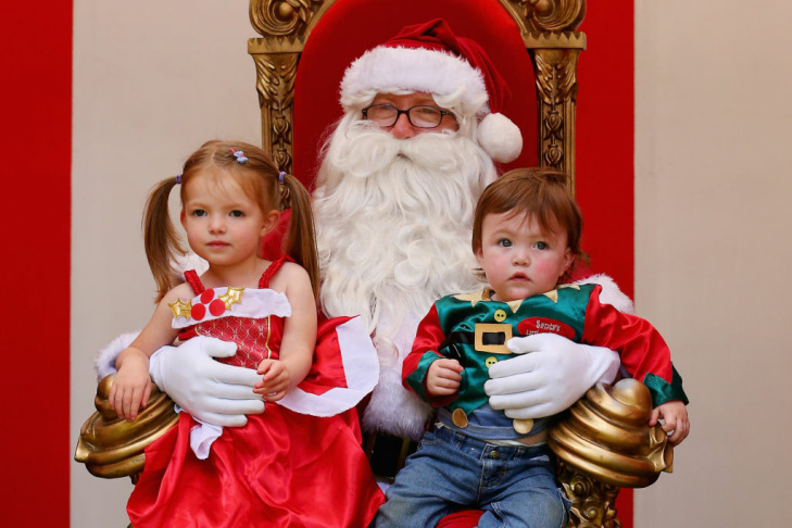 Children pose for a photo with Santa Claus as he visits Christmas Square on December 20, 2012 in Melbourne, Australia.