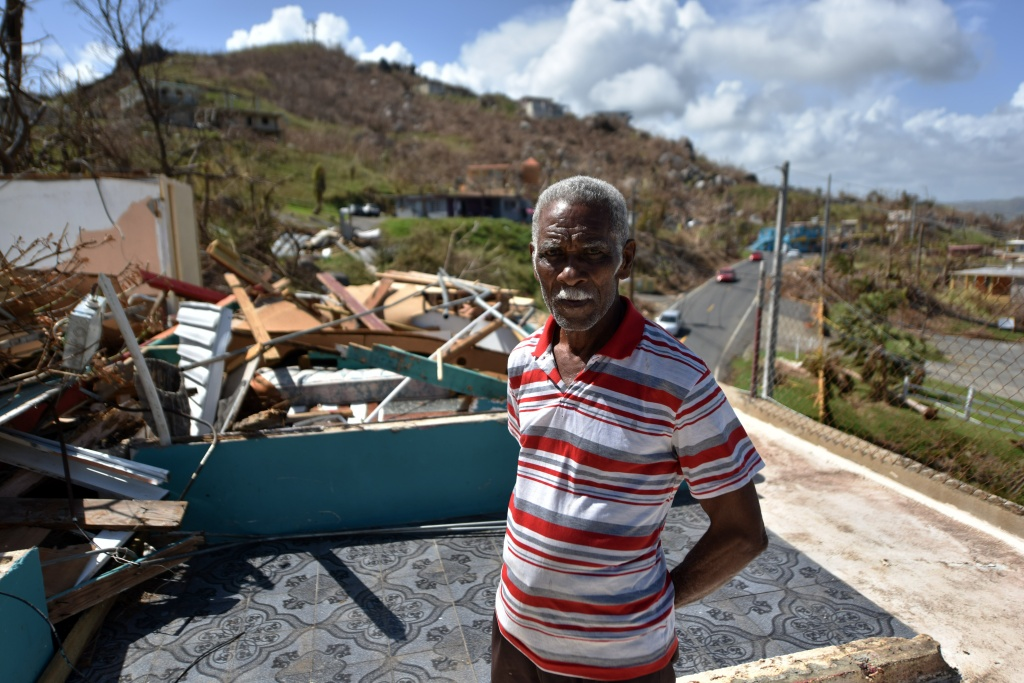 Carlos Pagan walks in his destroyed house by Hurricane Maria in Yabucoa, in the east of Puerto Rico, on September 28, 2017.