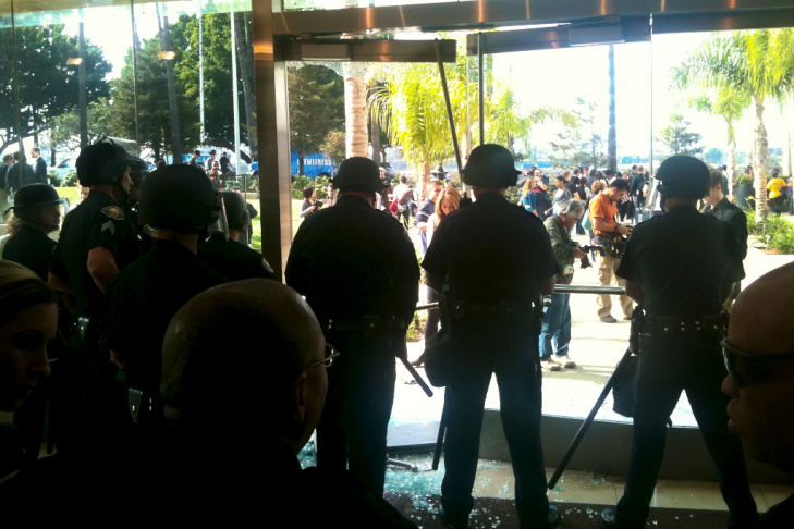 Protesters smashed one of the large glass doors leading into the CSU Board of Trustees' headquarters on Wednesday, Nov. 16, 2011.