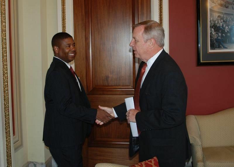 Charles Samuels, Director of the Federal Bureau of Prisons (Left) shakes hands with Senator Dick Durbin.