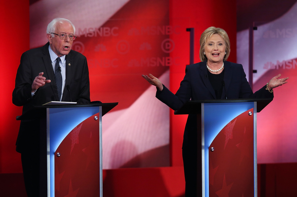 DURHAM, NH - FEBRUARY 04:  Democratic presidential candidates former Secretary of State Hillary Clinton and U.S. Sen. Bernie Sanders during their MSNBC Democratic Candidates Debate at the University of New Hampshire on February 4, 2016 in Durham, New Hampshire. This is the final debate for the Democratic candidates before the New Hampshire primaries.  (Photo by Justin Sullivan/Getty Images)