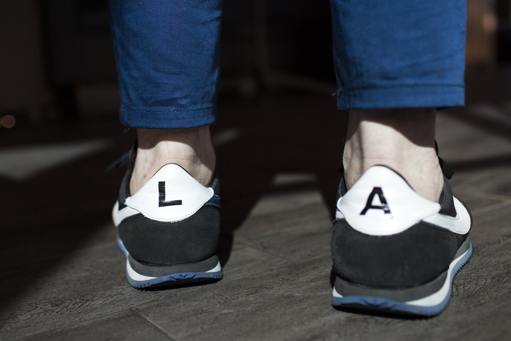 Executive Chef Vartan Abgaryan wears shoes representing Los Angeles at 71 Above, the new restaurant on the 71st floor of the U.S. Bank Tower in downtown Los Angeles, on Thursday afternoon, Sept. 22, 2016.