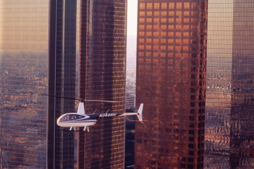 A Robinson R44 helicopter in flight over Los Angeles, CA