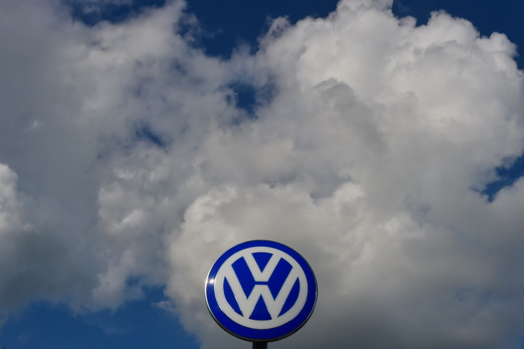 In this file photo, the logo of German car maker Volkswagen is pictured at the company's headquarters in Wolfsburg, central Germany, on September 25, 2015 during the company's supervisory board meeting. The company has agreed to pay out more than $15 billion to resolve issues related to its emissions cheats.