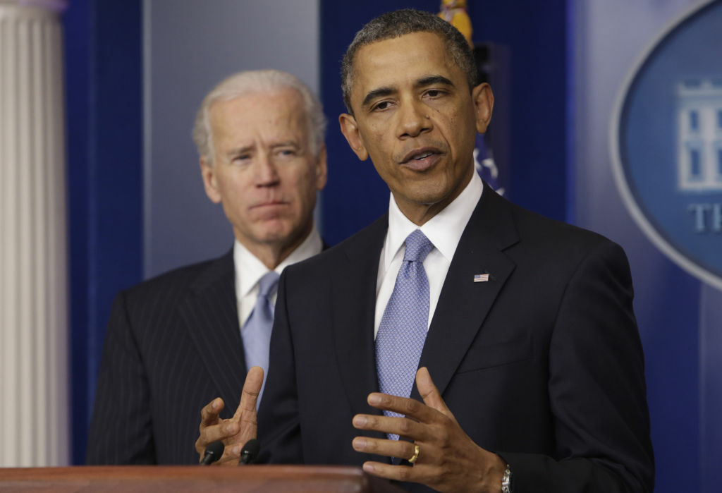 US President Barack Obama delivers a statement late January 1, 2013 at the White House in Washington DC. Obama said he had fulfilled a campaign promise to make the US tax system fairer with a deal to avert the fiscal cliff crisis that passed after a fierce duel in Congress. At left is US Vice President Joe Biden.