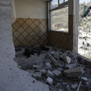 After Palestinian Abdel Rahman Shaludi killed two people with a car in an attack last month, Israel destroyed his family's apartment in East Jerusalem by blowing up the front outside and most internal walls. Israel says the aim is deterrence, while the Palestinians call it collective punishment.