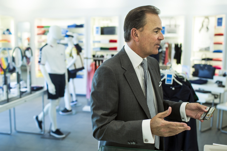 Rick Caruso, founder and CEO of Caruso Affiliated, buys a tennis hat on Wednesday, July 20, 2016 at The Americana at Brand in Glendale. Caruso is the developer of the retail and residential space.