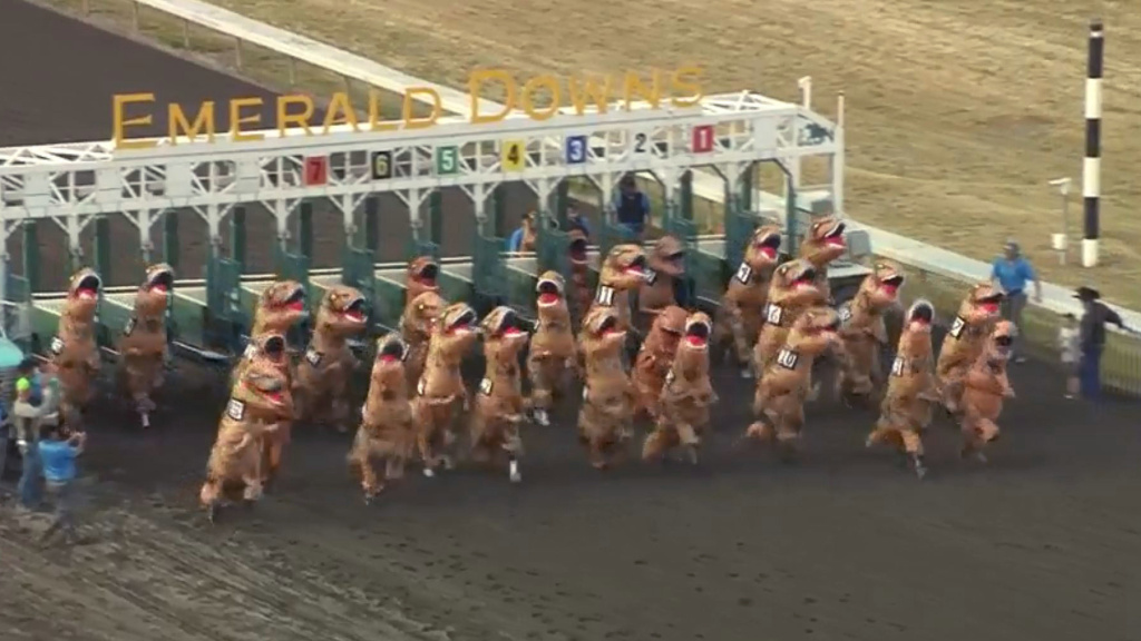 Racers wearing T-Rex costumes break out of the gate in a surprisingly fast — and hilarious — race at the Emerald Downs horse track in Washington state.