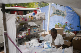 A nurse works in the Diquini hospital in Port-au-Prince on January 26, 2010.