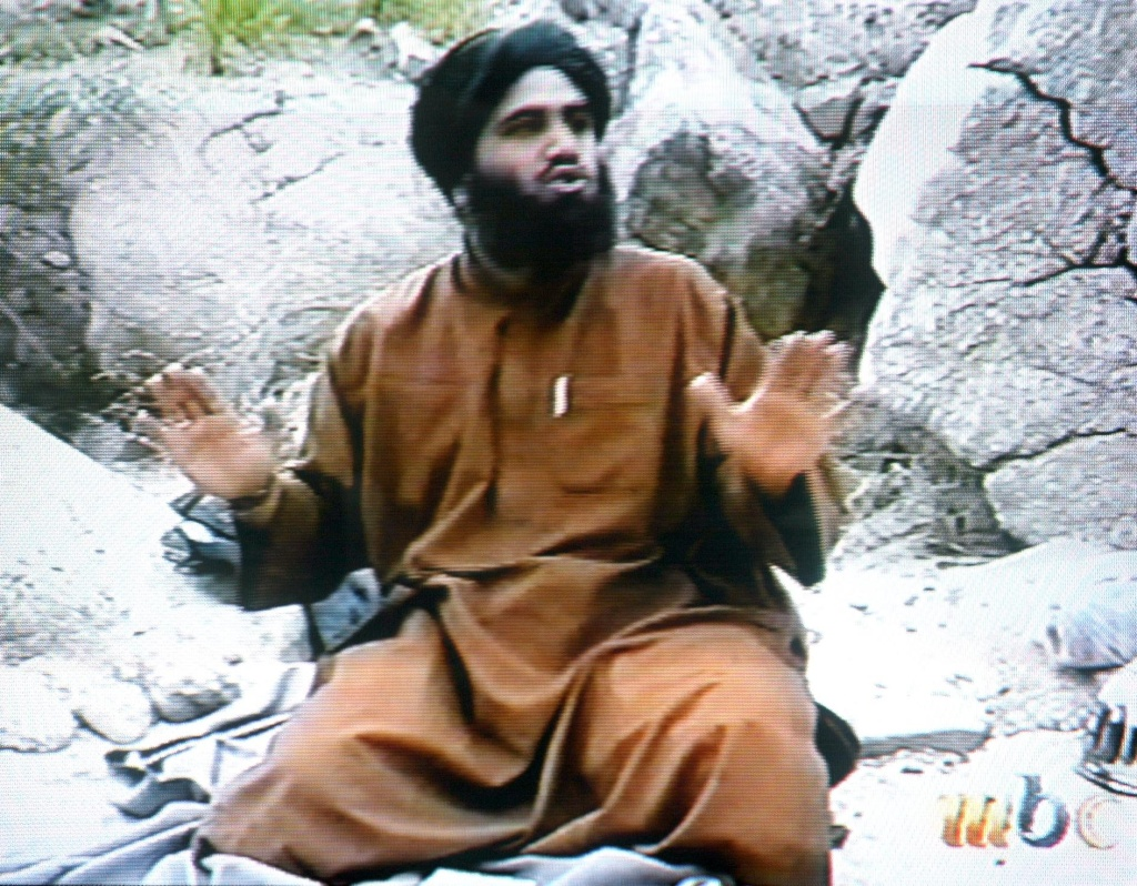 This frame grab from the Saudi-owned television network MBC (Middle East Broadcasting Center) shows Suleiman Abu Ghaith, the spokesman of alleged terror mastermind Osama bin Laden's al-Qaeda network, claiming responsibility for the September 11 suicide attacks in the United States in an undated videotape broadcast by the Dubai-based MBC 17 April 2002.