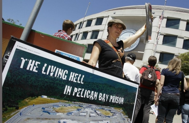 A demonstrator holds up a sign during a rally in front of the State Building in San Francisco on July 1, 2011 to support prisoners at Pelican Bay State Prison. Inmates in an isolation unit at Pelican Bay State Prison are on a hunger strike to protest conditions that they describe as inhumane. Advocates say several dozen inmates in the Security Housing Unit declined to eat their morning meal on Friday. The unit holds about a third of the 3,100 inmates at the Northern California prison.