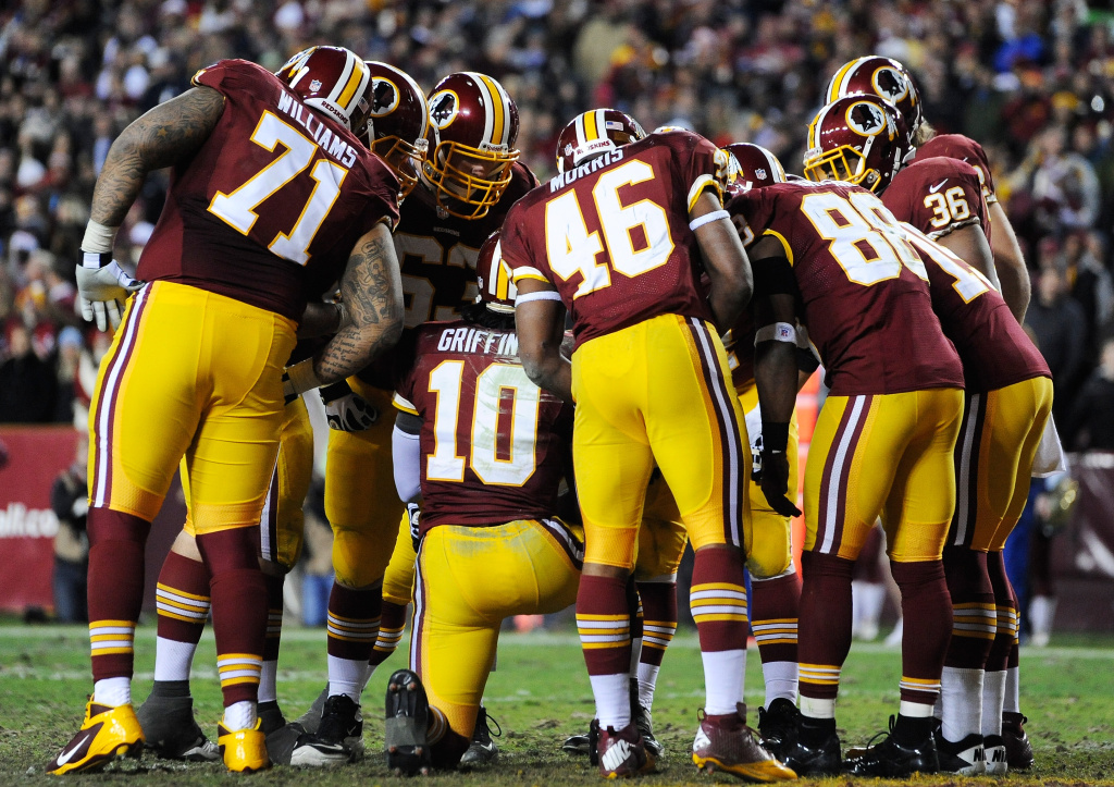 The Washington Redskins huddle around Robert Griffin III #10 during the NFC Wild Card Playoff Game against the Seattle Seahawks at FedExField on January 6, 2013 in Landover, Maryland.