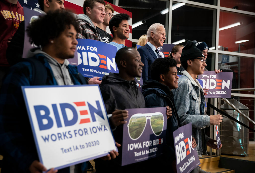 Democratic presidential candidate, former Vice President Joe Biden poses for a photograph with students during an event at Iowa Central Community College on January 21, 2020 in Fort Dodge, Iowa.