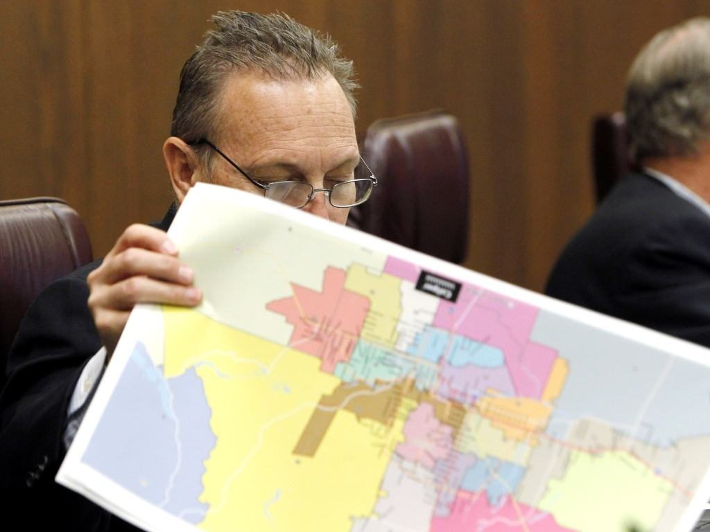 Arizona state Sen. Andy Biggs flips through redistricting maps during a special legislative committee hearing to discuss the state commission's proposed maps in 2011.