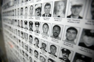 Photographs of firefighters killed on 9/11 are seen outside the World Trade Center site after the death of  Osama bin Laden was announced May 2, 2011 in New York City.