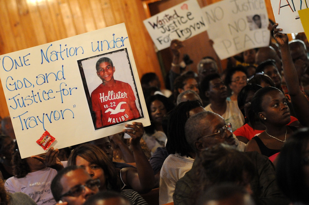 Civil rights leaders and residents of the city of Sanford attend to a town hall meeting to discuss the death of a 17-year-old unarmed black teen Trayvon Martin who was shot by a neighborhood watch captain on March 20, 2012 in Sanford, Florida.