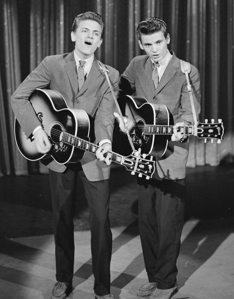 "The Everly Brothers (Phil on the left, Don on the right) singing on ""The Ed Sullivan Show"" in 1957."
