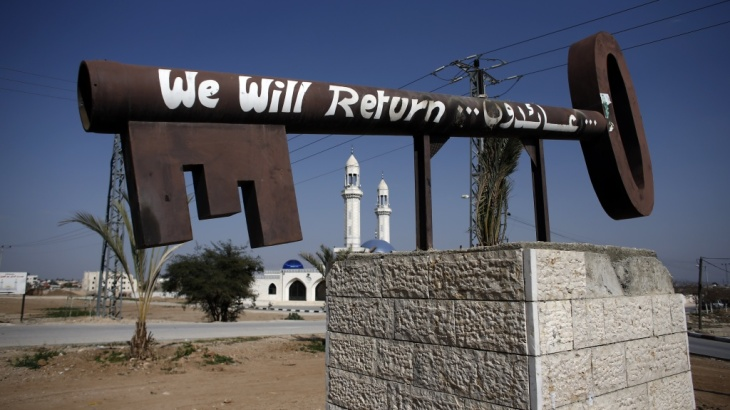 A key, symbolizing the Palestinians who lost their homes at the creation of the state of Israel in 1948, sits at the entrance of the West Bank city of Jericho, on Feb. 22.
