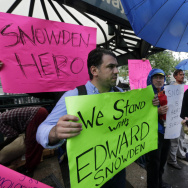 Demonstrators hold signs supporting Edward Snowden in New York's Union Square Park, on Monday. Snowden, who says he worked as a contractor at the National Security Agency and the CIA, gave classified documents to reporters, making public two sweeping U.S.