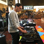 """Alejandro Cohen, director of music collective and online radio station Dublab, plays music at Union Station for the """"Music for Train Stations"""" series."""
