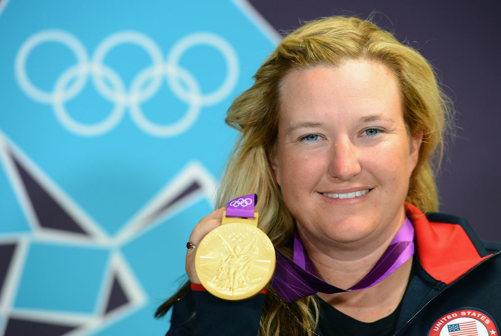 Kimberly Rhode of the United States poses with her gold medal at a press conference at The Main Press Center.
