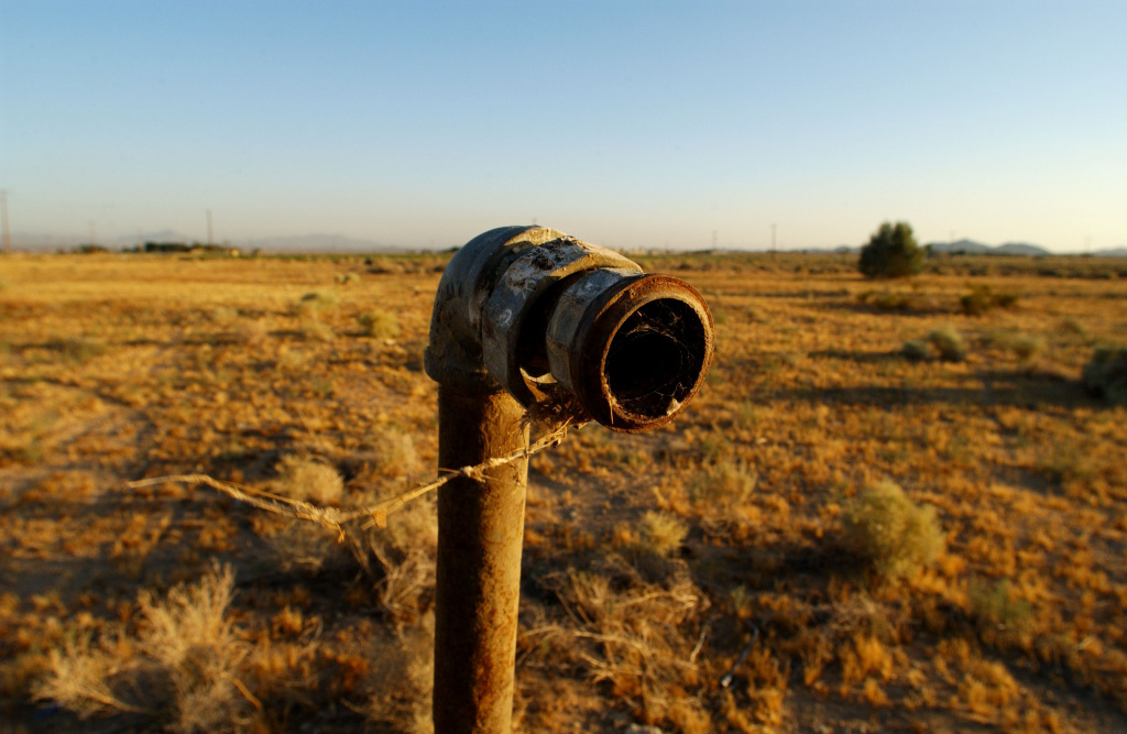 A pipe is one of the few signs that houses once stood on the property where Pacific Gas & Electric bought and razed them after the company was found to have polluted the ground water with cancer-causing hexavalent chromium for 30 years. The community's pollution struggle inspired the movie 'Erin Brockovich.'
