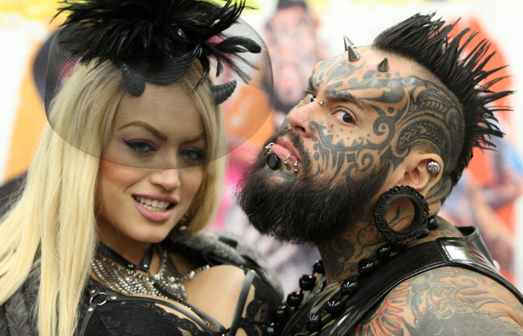 Tattoo artists pose for a picture at the 25th international Tattoo Convention in Frankfurt, Germany, on April 22, 2017.