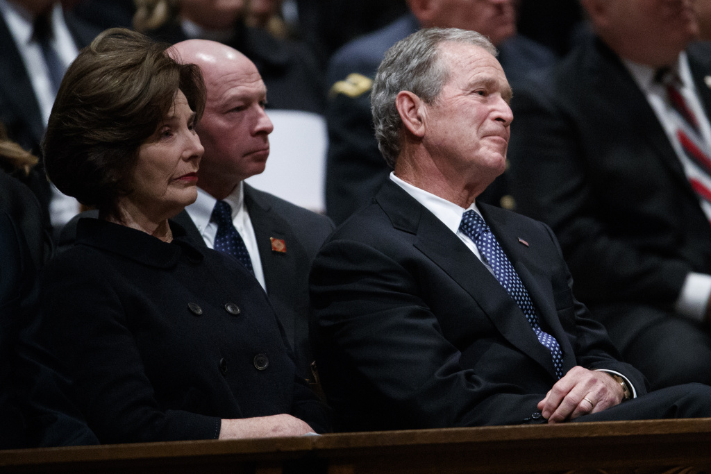 Former President George W. Bush and Laura Bush look on during the state funeral for his father, former President George H.W. Bush, at the National Cathedral on Wednesday.