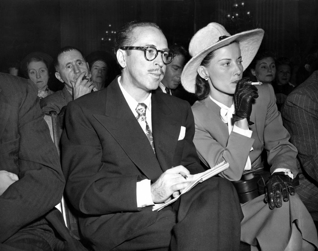 In this Oct. 28, 1947 file photo, screenwriter Dalton Trumbo, left, and his wife, Cleo, listen from the audience as the chairman of the House Un-American Activities Committee (HUAC) announces a contempt citation against Trumbo at a hearing in Washington, D.C.