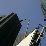 Crew members set up a camera for the shooting of an auto insurance commercial on-location downtown on November 18, 2006 in Los Angeles, California.